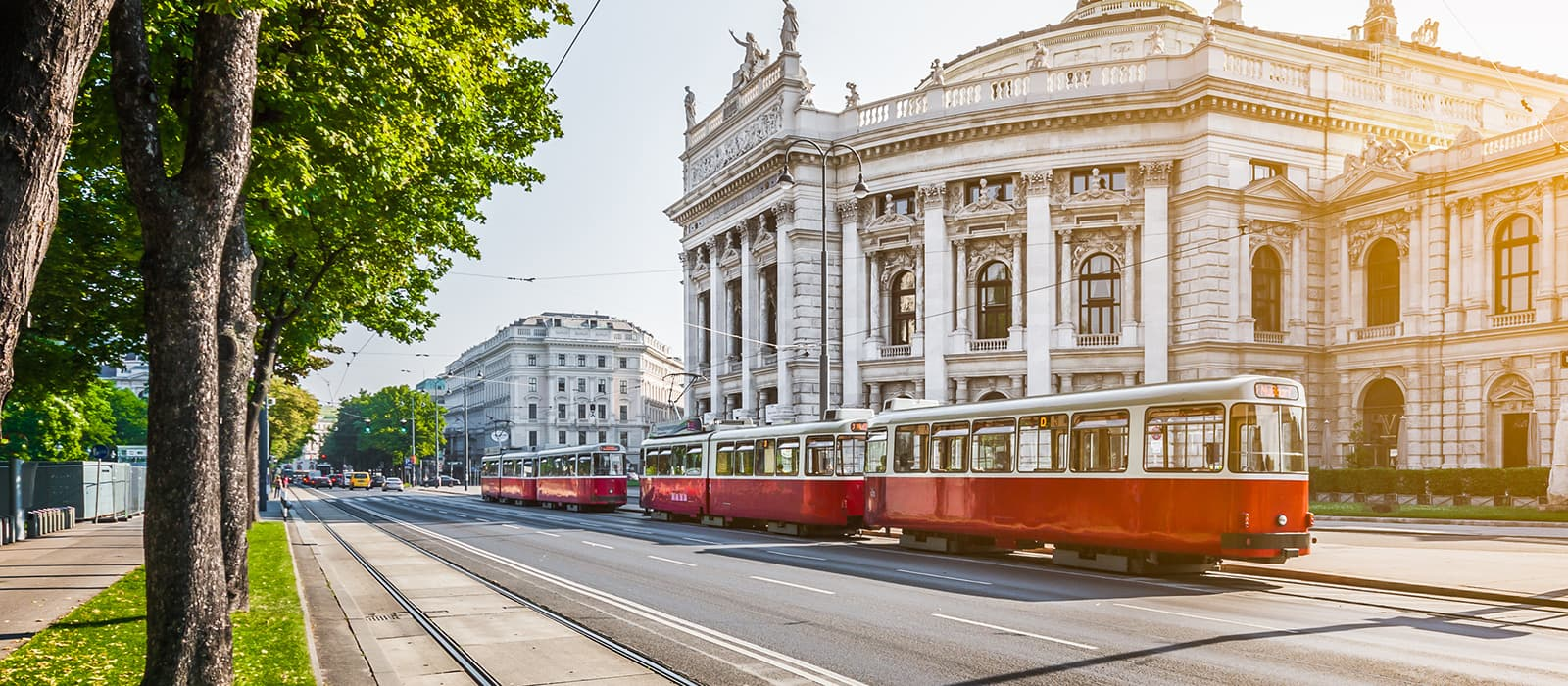 A tramway passes by the imperial theater in Vienna
